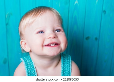 smiling emotional baby portrait summer style on blue wooden background. present for holidays mother woman day easter