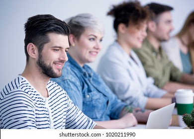 Smiling employee cooperating with friendly team in the corporation
