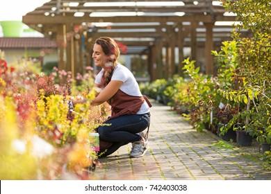 Smiling employee in garden center