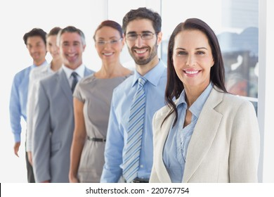 Smiling employee's in a line at work