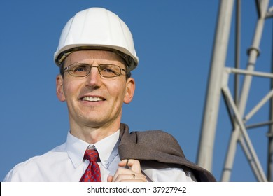 Smiling engineer in front of steell construction