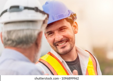 smiling engineer happy to working together talking with business man