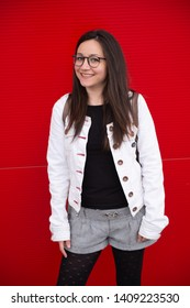 Smiling and enjoying in front of a red background