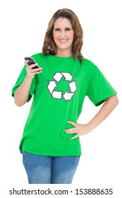 Smiling environmental activist holding phone looking at camera against white background