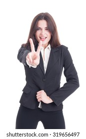 Smiling excited and enthusiastic business woman showing peace or victory gesture isolated on white