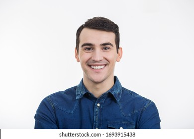Smiling excited young man isolated on white background. Close-up shot of Happy smiling student in shirt over white background.Happiness