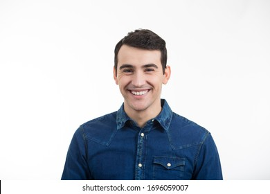 Smiling excited young man isolated on white background. Close-up shot of Happy smiling student in shirt over white background. Happiness