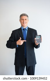 Smiling executive showing calculator