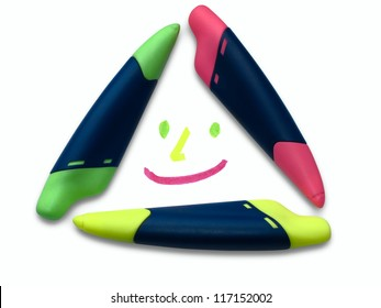 A smiling face made by and of three markers on a white background