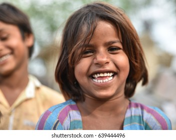 Smiling face portrait of a young child or young girl from rural part of India