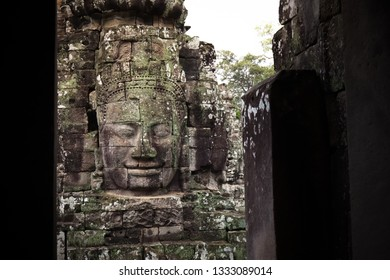 Smiling Faces of Bayon temple in Angkor Thom ancient ruin near Angkor Wat, Siem Reap, Cambodia One of the most magnificent lost civilization in the world.