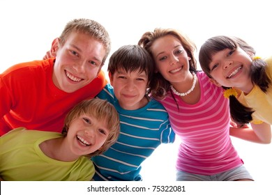 Smiling faces of several happy children.  White background