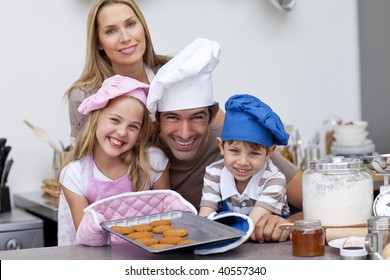 Smiling family baking biscuits in the kitchen