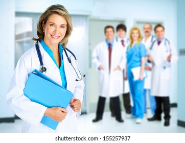 Smiling family doctor woman with stethoscope. Health care.