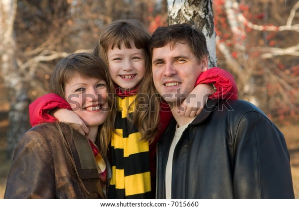 Smiling Family. Father, mother and daughter.