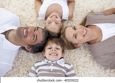 Smiling family lying on floor with heads together