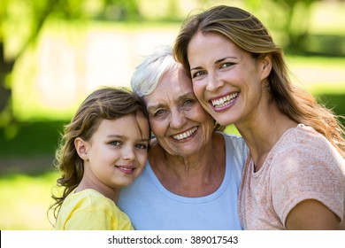 Smiling family standing in the garden