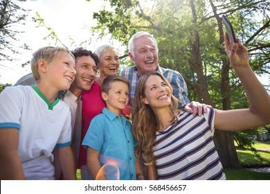 Smiling family taking selfie in the garden