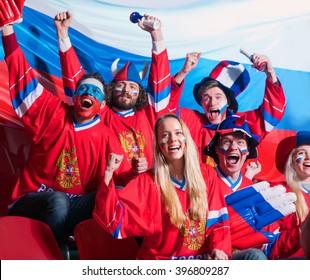 Smiling fans in stadium