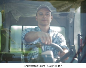Smiling farmer driving a tractor
