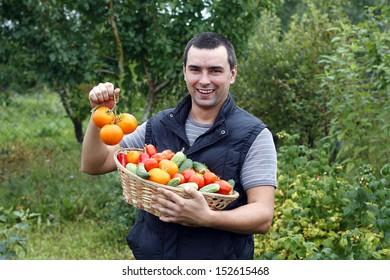 smiling farmer holding vegetables basket
