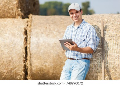 Smiling farmer using a tablet