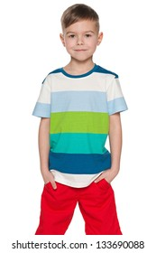 A smiling fashion young boy on the white background