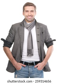 Smiling fashionable man wearing a scarf and gray clothes isolated over a white background