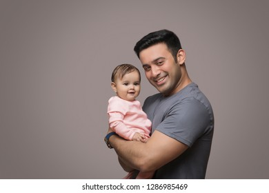 Smiling Father Holding baby girl