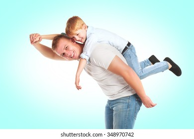Smiling father playing with his son flying isolated