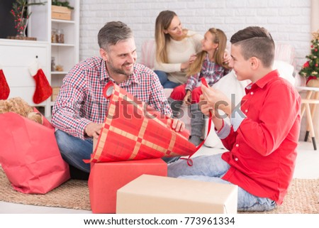Smiling Father Son Packing Gifts Mother Stock Photo (Edit