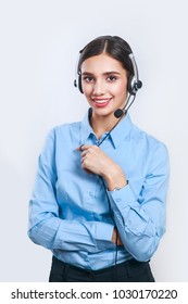 Smiling female agent in headset. Woman customer service worker