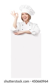 smiling female chef, cook or baker above banner with empty copy space for you text showing an okay sign isolated on white background. proposing service. advertisement blank board. your text here