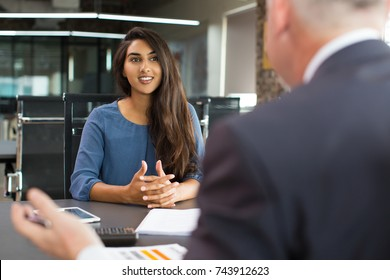 Smiling female client talking to male manager