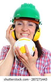 Smiling female construction worker with protective mask wearing green helmet and protective headphones, safety at work and ear protection. White background