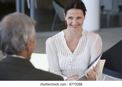 Smiling female consultant talking with a client