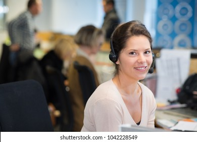 smiling female customer service agent wearing headset