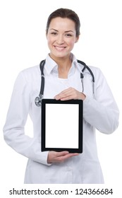 Smiling female doctor with stethoscope showing blank digital tablet pc. Isolated.