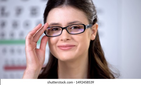 Smiling female enjoying appearance in new eyeglasses, ophthalmology check-up