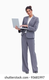 Smiling female entrepreneur with her laptop against a white background
