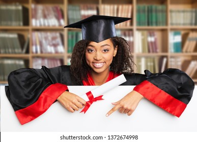 Smiling female graduate holding a sign with diploma . XXXL