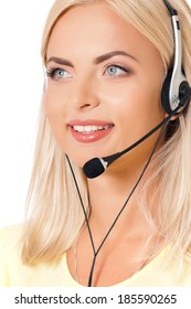 Smiling female helpline operator with headphones giving a consultation