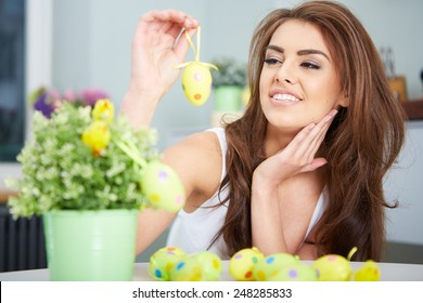a smiling female laughing with colorful easter eggs