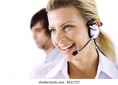 smiling female operator, male working in the background