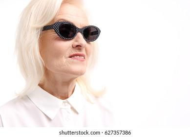 Smiling female person wearing dark eyewear