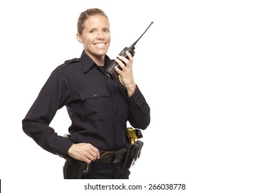 Smiling female police officer talking on a radio against white background