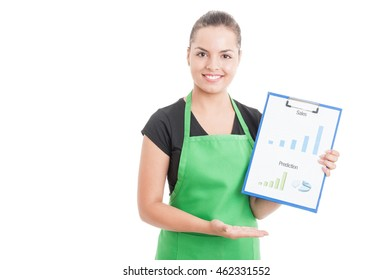 Smiling female seller showing profit chart report on clipboard isolated on white background