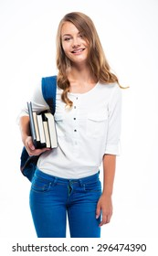 Smiling female student with backpack holding books isolated on a white background