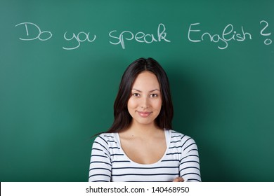 smiling female student in classroom learning english