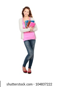 A smiling female student holding books isolated on white background
